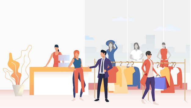 Compratori che scelgono e acquistano vestiti in negozio