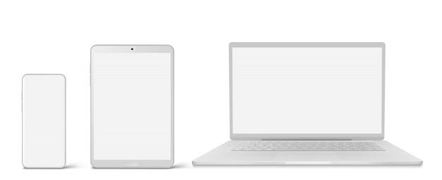 Computer portatile, tablet e telefono bianchi con lo schermo in bianco
