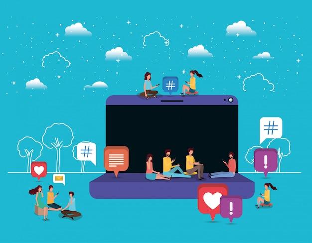 Comunità sociale che utilizza smartphone con laptop