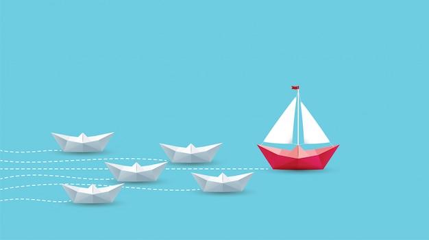 Concetto di direzione, barca di carta rossa di origami.