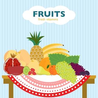 Concetto di frutta piatto colorato con prodotti maturi freschi biologici posa sul tavolo