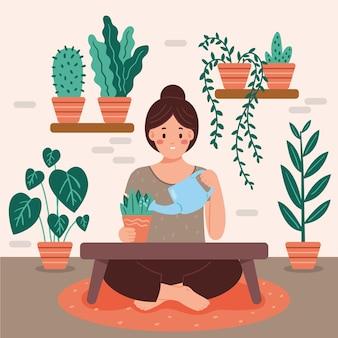 Concetto di giardinaggio a casa con le piante di innaffiatura della donna