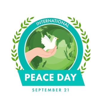 Concetto di giornata internazionale della pace con mano umana che tiene colomba, foglie di ulivo e globo terrestre su sfondo bianco.