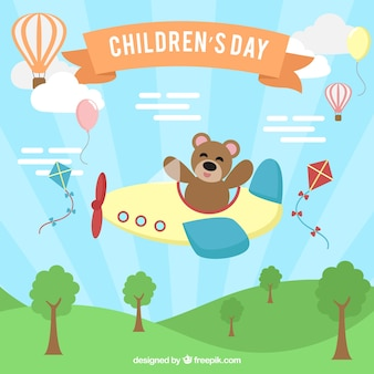 Concetto di giorno dei bambini con l'orsacchiotto che vola un aereo