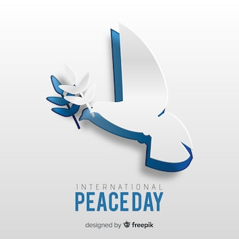 Concetto di giorno di pace con carta colomba