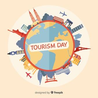 Concetto di giorno di turismo mondiale con design piatto