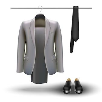 Concetto di guardaroba. elementi essenziali dell'uomo d'affari, abito grigio, cravatta e scarpe nere