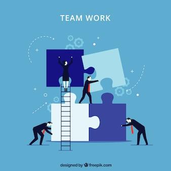 Concetto di lavoro di squadra blu con pezzi di puzzle