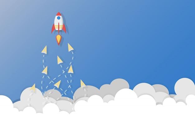 Concetto di leadership, lavoro di squadra e coraggio, rocket per leader e aerei di carta che volano seguono il leader del razzo su cielo.