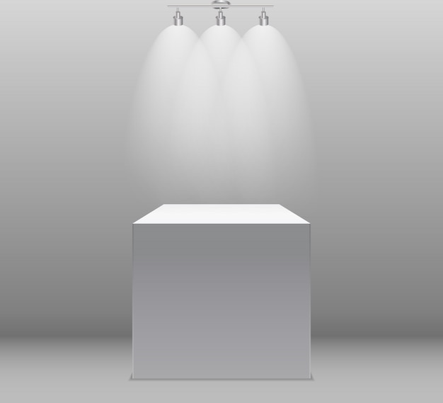 Concetto di mostra, scatola bianca vuota, stand con illuminazione su muro grigio