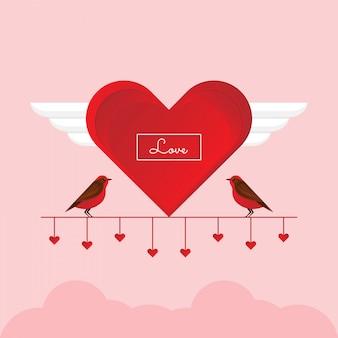 Concetto di san valentino. uccelli svegli dell'amante delle coppie sul ramo rosso