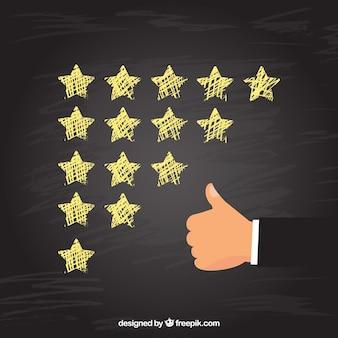 Concetto di valutazione della stella della lavagna con la mano che fa gesto giusto