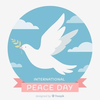 Concetto internazionale di giorno di pace con la colomba bianca
