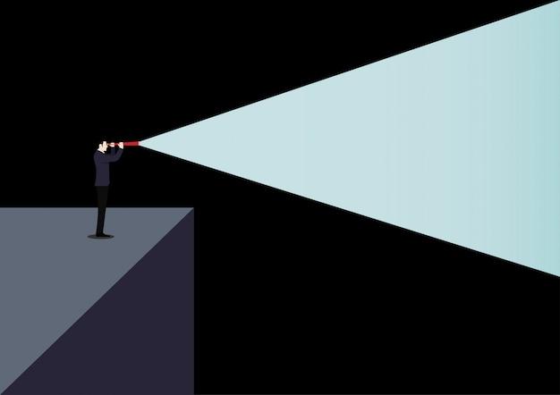 Concetto visionario di direzione di affari con la luce del telescopio nel buio