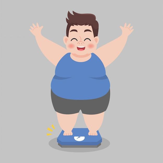 Condizione felice del grande uomo grasso sulle bilance elettroniche per il peso corporeo.