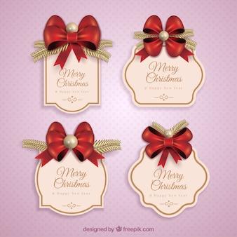 Confezione da eleganti adesivi di natale con i nastri rossi