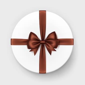 Confezione regalo bianca con fiocco e nastro di cioccolato marrone