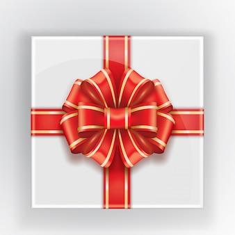 Confezione regalo con fiocco rosso con tratto dorato.