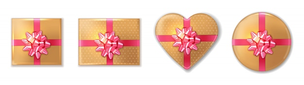 Confezione regalo dorata con fiocco rosa