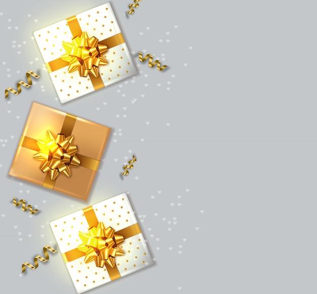 Confezioni regalo con fiocco dorato