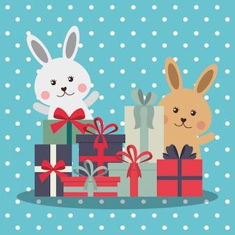 Conigli carini con scatole regalo impilati su sfondo punti