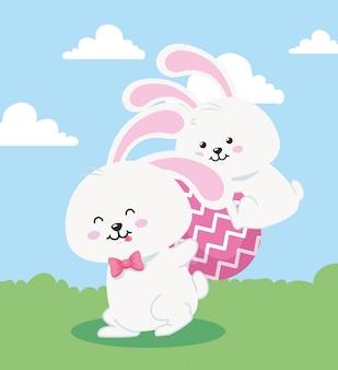 Conigli con l'uovo di pasqua nella progettazione dell'illustrazione di vettore del paesaggio