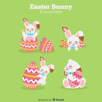 Coniglietti pasquali con raccolta di uova decorate
