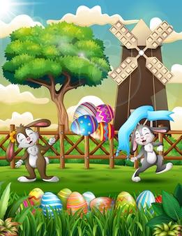 Coniglietti pasquali felici che ballano in primavera azienda agricola sfondo