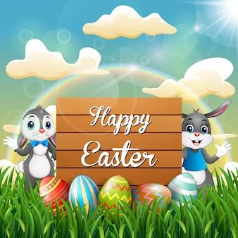 Coniglietto di pasqua del fumetto con le uova di pasqua accanto ad un segno di legno