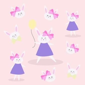 Coniglietto sveglio della bambina che tiene pallone giallo con il modello del fronte sul rosa per abbigliamento dei bambini