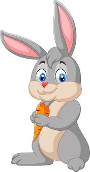 Coniglio del fumetto che tiene una carota