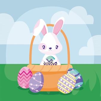 Coniglio del fumetto con le uova di pasqua in un cestino