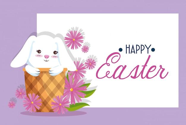Coniglio felice dentro il canestro alla decorazione della carta di pasqua