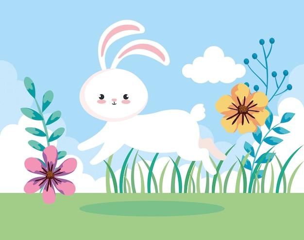 Coniglio sveglio di pasqua che salta nel paesaggio