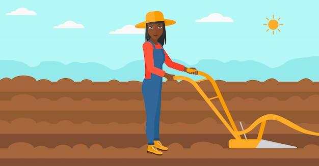 Contadino sul campo con aratro.