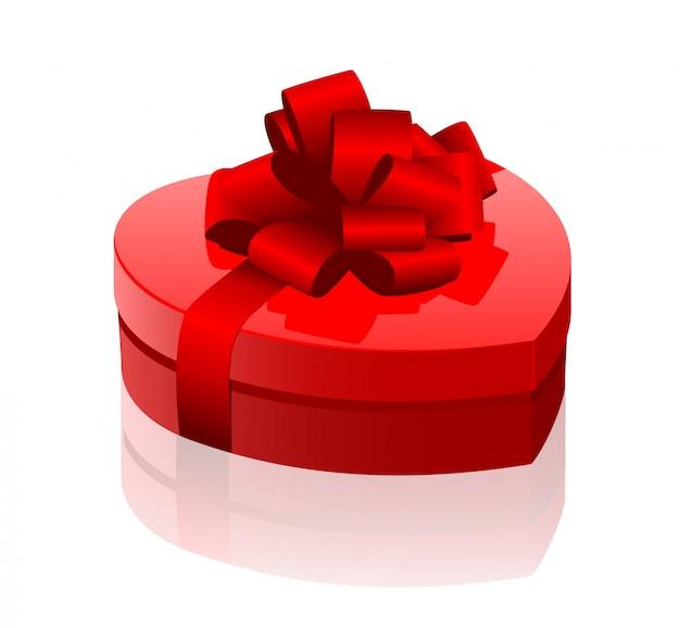 Contenitore di regalo lucido del cuore rosso con l'arco rosso isolato su fondo bianco