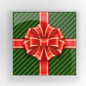 Contenitore di regalo verde con una vista superiore dell'arco rosso.