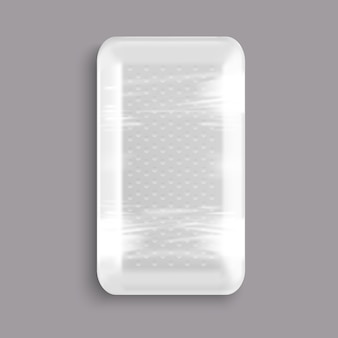 Contenitore in plastica bianco avvolto in un vassoio di plastica per alimenti