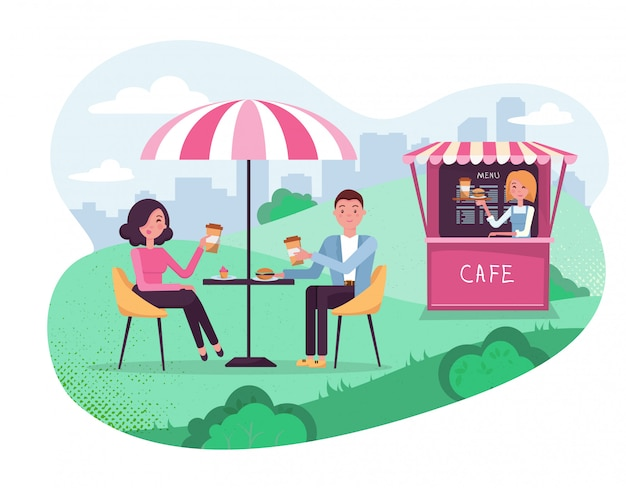 Coppia alla data del fine settimana. la gente beve il caffè con l'hamburger in outdoor street cafe. parco