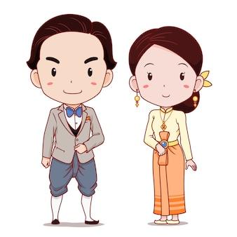 Coppia carina di personaggi dei cartoni animati in costume tradizionale thailandese applicato.