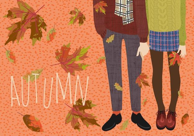 Coppia di adolescenti e foglie di autunno che cadono.