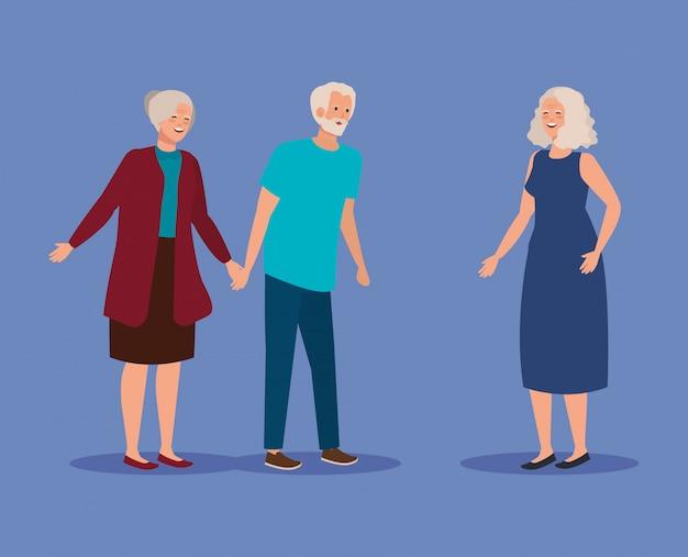 Coppia di anziani insieme a donna anziana