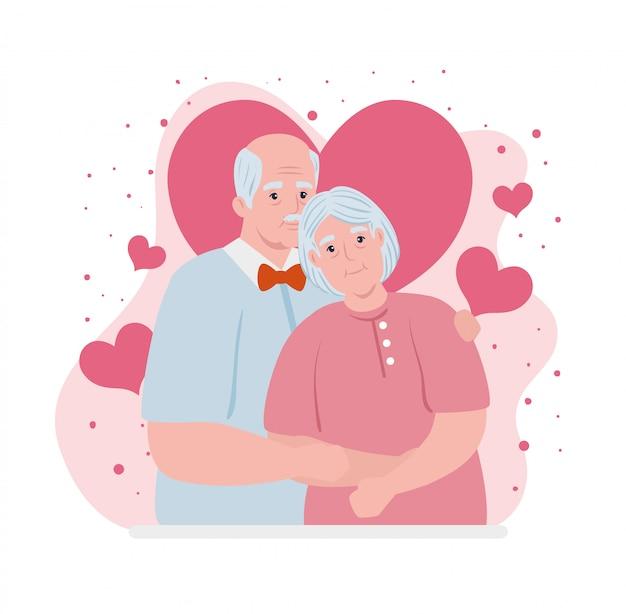 Coppia di anziani sorridente, vecchia e coppia di anziani in amore, con decorazione di cuori