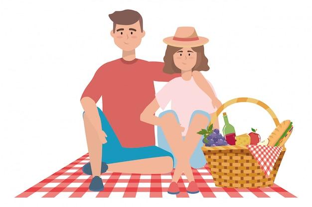 Coppia di donna e uomo che hanno picnic