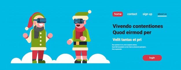 Coppia di elfi ragazza aiutante di babbo natale indossare occhiali per realtà virtuale buon natale vacanze capodanno