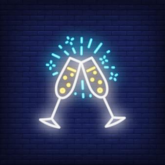 Coppia di flauti champagne. elemento di segno al neon