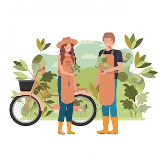 Coppia di giardinieri con paesaggio e bicicletta