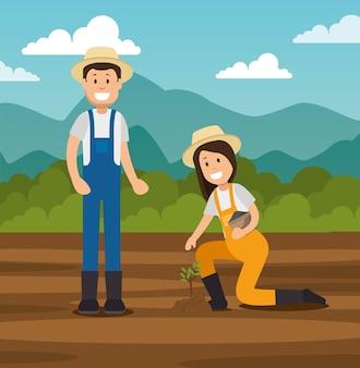 Coppia di giovani giardinieri che fanno lavori di giardinaggio