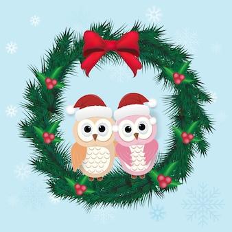 Coppia di gufi e ghirlanda di pino natalizio