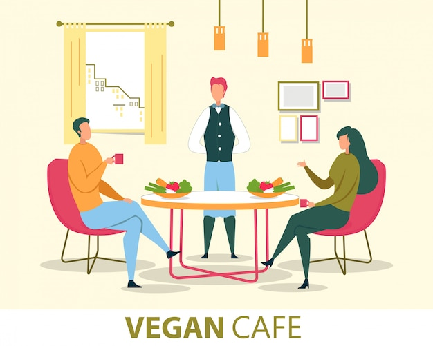 Coppia di mangiare nel vegan cafe